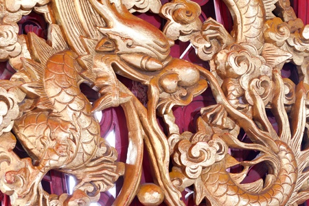 Ancient statue of Golden Chinese dragon in chinese temple. Stock Photo - 12430849