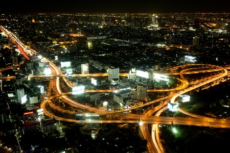Big City Highway Interchange in Thailand, on night time. photo