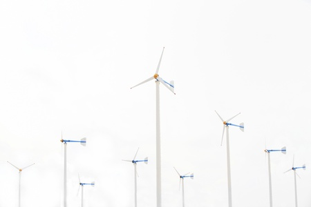 Many white wind turbine generating electricity on isolated background  photo