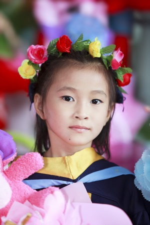 Achievement of degree for young babay in the green nature   photo