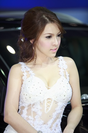 Bangkok, Thailand - March 28  female model posing near a car at Bangkok Motor Show 2012 on March 27- Apr 8, 2012
