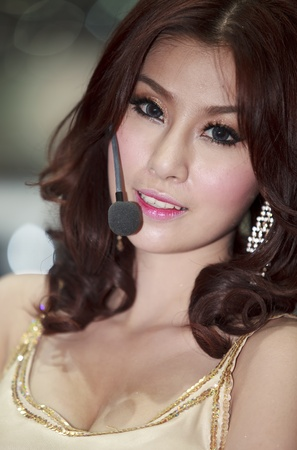 Bangkok, Thailand - March 28  female model posing near a car at Bangkok Motor Show 2012 on March 27- Apr 8, 2012