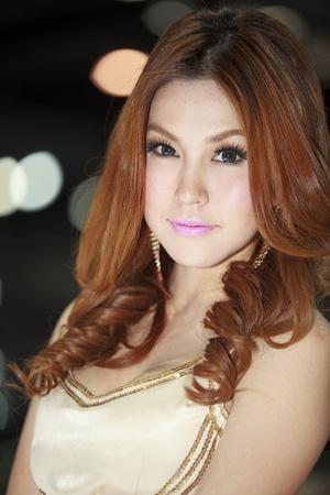 Bangkok, Thailand - March 28: female model posing near a car at Bangkok Motor Show 2012 on March 27- Apr 8, 2012 Stock Photo - 12925845