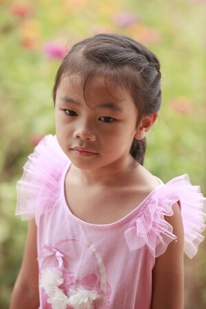 Asian cute children in green nature backgrond  Stock Photo - 13050329