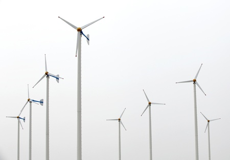 Many white wind turbine generating electricity on isolated background. photo