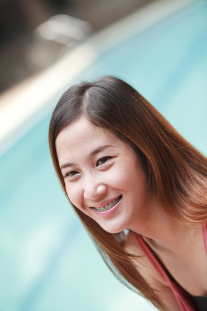 Young long hair Asia women action in a swiming pool photo