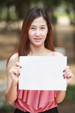 Young long hair Asia women and blank paper for put your text and your job  photo