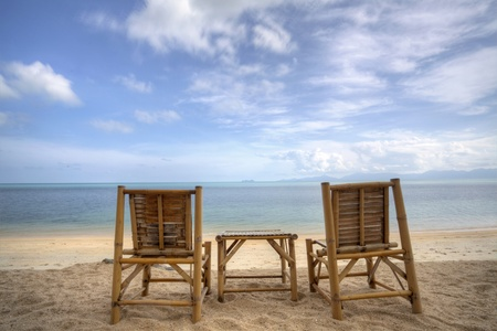 Two bamboo beach chair with blue sky and sea view  photo