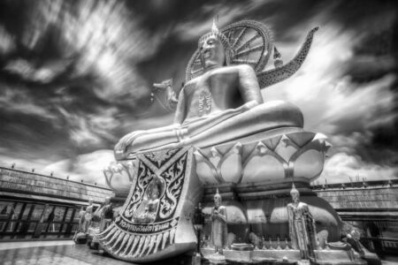 venerate: Big Buddha in Wat Phra Yai Temple, Koh Samui island, black and white color, Thailand  Stock Photo