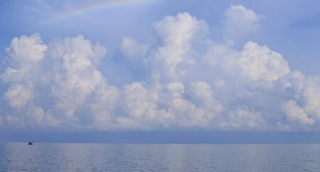 Big cloud on the ocean before Typhoon will destroy the boat  photo