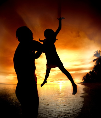 silhouette family of child hold on father hand with sea view  photo