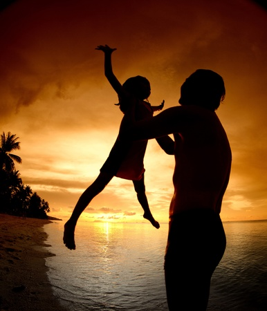 silhouette family of child hold on father hand with sea view Stock Photo - 13260556
