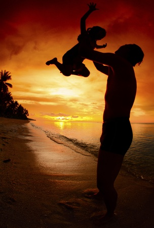 silhouette family of child hold on father hand with sea view. Stock Photo - 13246356