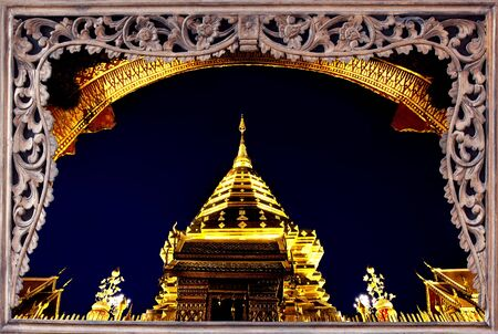 Goldent pagoda on top of Suthap Mountain with wooded frame. The collection of best please travel of Thailand. Stock Photo - 13334435