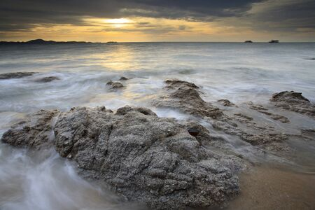 Big wave and the rock with sunset sky at Pattayabeach, Thailand Stock Photo - 13497707