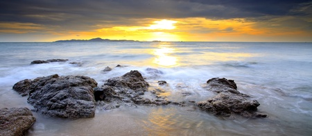 Big wave and the rock with sunset sky at Pattayabeach, Thailand Stock Photo - 13497694