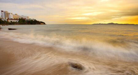 Big wave and the rock with sunset sky at Pattayabeach, Thailand Stock Photo - 13497678