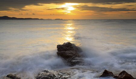 Big wave and the rock with sunset sky at Pattayabeach, Thailand Stock Photo - 13497693