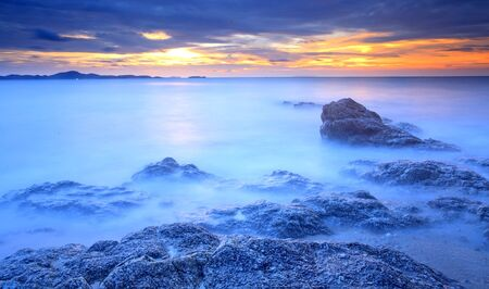 Big wave and the rock with sunset sky at Pattayabeach, Thailand  Stock Photo - 13497709