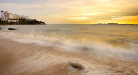Big wave and the rock with sunset sky at Pattayabeach, Thailand. Stock Photo - 13643763