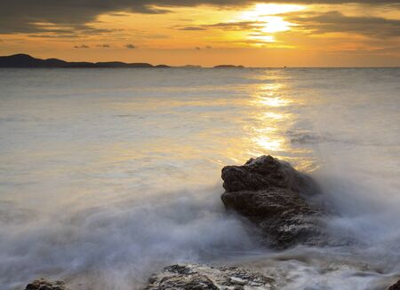 Big wave and the rock with sunset sky at Pattayabeach, Thailand. Stock Photo - 13643764