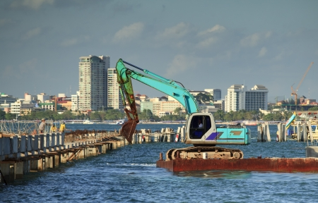 Vehicle work on the sea for construction work. photo