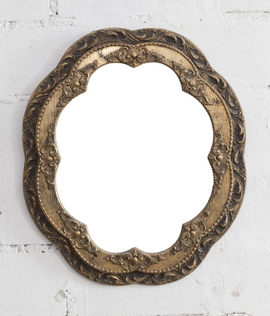 Vintage classical frame on white brickbackground, with cut out work part of frame. photo