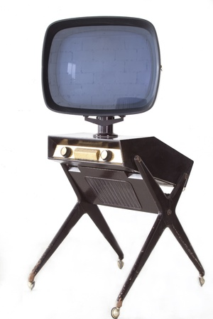 tv set: classic and ancient talevision with white wall and rolled table.