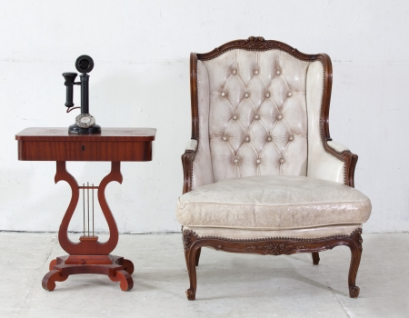 ancient leather sofa and telephone in white room  photo
