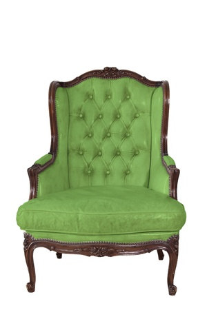 ancient green leather armchair whit white wall background. photo