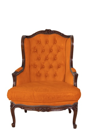 ancient orange leather armchair whit white wall background. photo