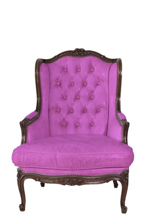 ancient pink leather armchair whit white wall background. photo