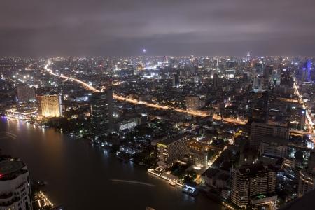 Bangkok city at twilight whit express way and cho pra-ya river, Thailand. photo