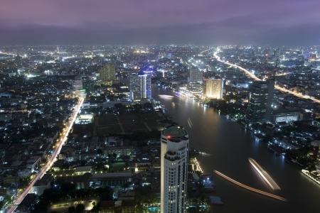 praya: Bangkok city at twilight whit express way and cho pra-ya river, Thailand. Stock Photo