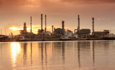 Landscape of river and oil refinery factory between sun rise time in Chao praya river, Bangkok, Thailand. Stock Photo - 14297282