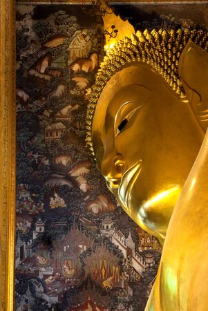 Ancient face of buddha hidden in the wall with eye contact. Wat pho (Thai royal palace) is very famous place travel in Thailand. This is government place and not properties of any persons, all persons can visit and take aphoto. This place can take a photo photo