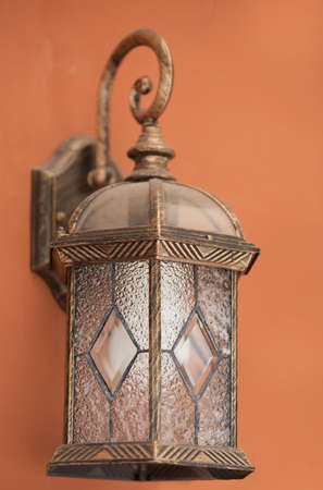 vintage wall lamp with orange background. Stock Photo - 14297294