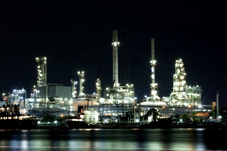 praya: Landscape of river and oil refinery factory between sun rise time in Chao praya river, Bangkok, Thailand.