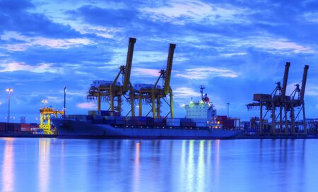 Container Cargo freight ship with working crane bridge in shipyard at dusk for Logistic Import Export background Stock Photo - 14457968