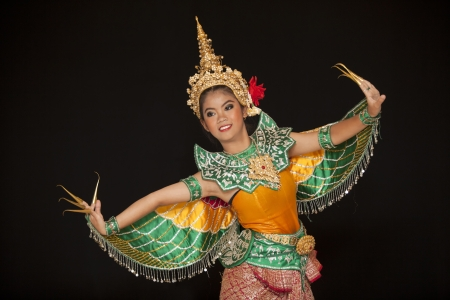 Portrait of Thai young lady in an ancient Thailand dance wea with isolated  background.