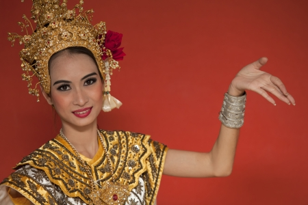 thai dancing: Portrait of Thai young lady in an ancient Thailand dance wea with isolated  background.
