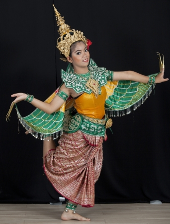 cultural history: Portrait of Thai young lady in an ancient Thailand dance wea with isolated  background.