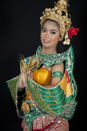 thai dance: Portrait of Thai young lady in an ancient Thailand dance wea with isolated  background.
