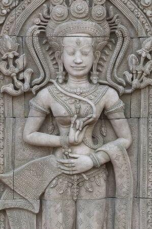 Apsara sculptures at Angkor Wat, made around the 12th Century   photo