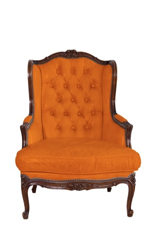 ancient orange leather armchair whit white wall background  photo