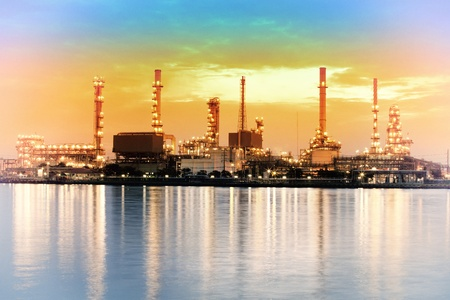 Landscape of river and oil refinery factory between sun rise time in Chao praya river, Bangkok, Thailand  photo