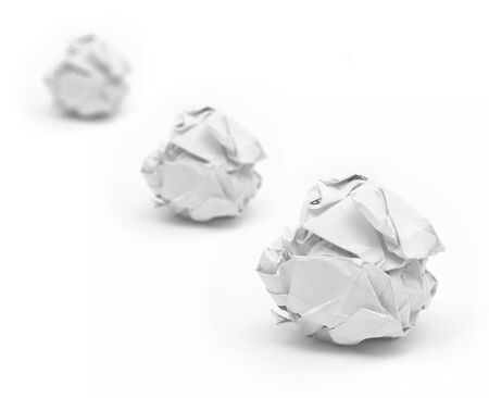Selective focus of close-up of crumpled paper ball with white background  photo
