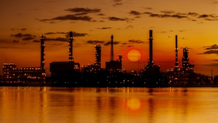 Refinery industrial plant with river and sunset photo