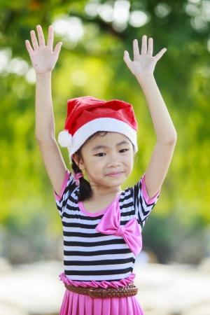 Asian kid with santa had. Stock Photo - 16311592