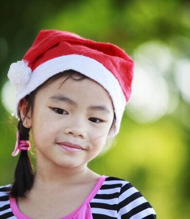 Asian kid with santa had. Stock Photo - 16311593
